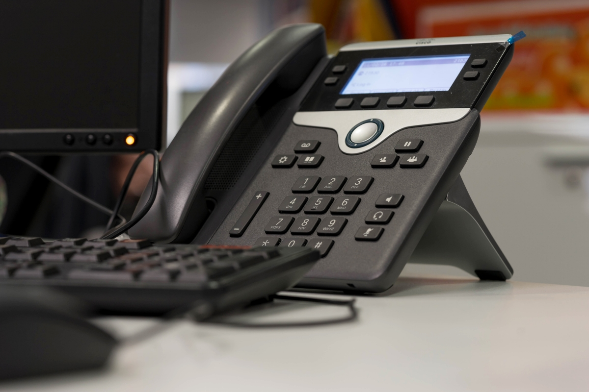 ip phone and computer on desk at office manager